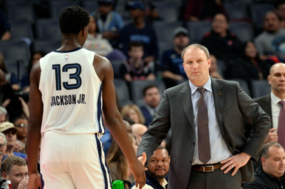 <strong>Memphis Grizzlies coach Taylor Jenkins welcomes Jaren Jackson Jr. (13), who heads to the bench during the first half of the team's NBA basketball game against the Golden State Warriors on Tuesday, Nov. 19, 2019, in Memphis, Tenn.</strong> (AP Photo/Brandon Dill)