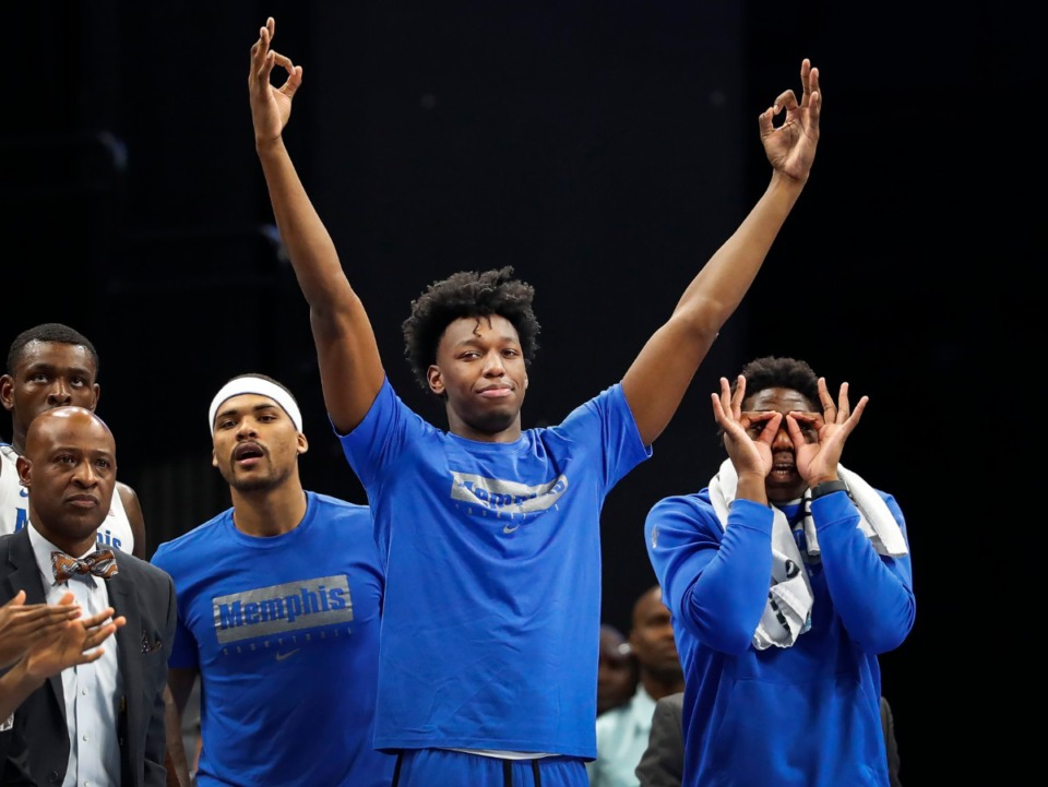 <strong>Memphis suspended center James Wiseman (middle) celebrates a 3-pointer against Little Rock Nov. 20 at the FedExForum.</strong> (Mark Weber/Daily Memphian)