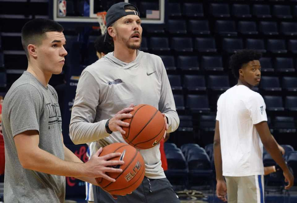 <strong>University of Memphis assistant basketball coach Mike Miller (center) works out with players before the game against Christian Brothers at FedEx Forum Friday night. Miller played seven seasons with the Memphis Grizzlies.&nbsp;</strong>(Karen Pulfer Focht/Special to The Daily Memphian)