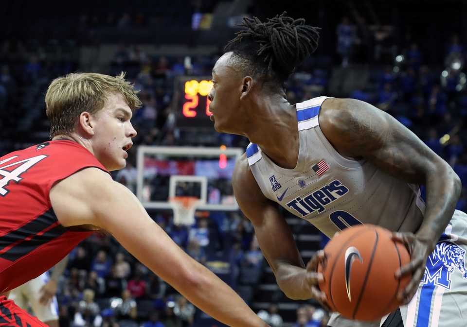 <strong>Christian Brothers' Jacob Lyons (44) goes in to block Memphis' Kyvon Davenport during first half action in the exhibition basketball game at FedExForum Friday night.</strong> (Karen Pulfer Focht/Special to The Daily Memphian)
