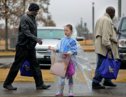 <strong>Young Savanna Finklea helps direct traffic and collect tickets at Tiger Lane on Nov. 21, 2019, while helping Smithfield Foods, Kroger and the Mid-South Food Bank distribute more than 2,000 Thanksgiving meals to veterans in the Mid-South.</strong> (Patrick Lantrip/Daily Memphian)