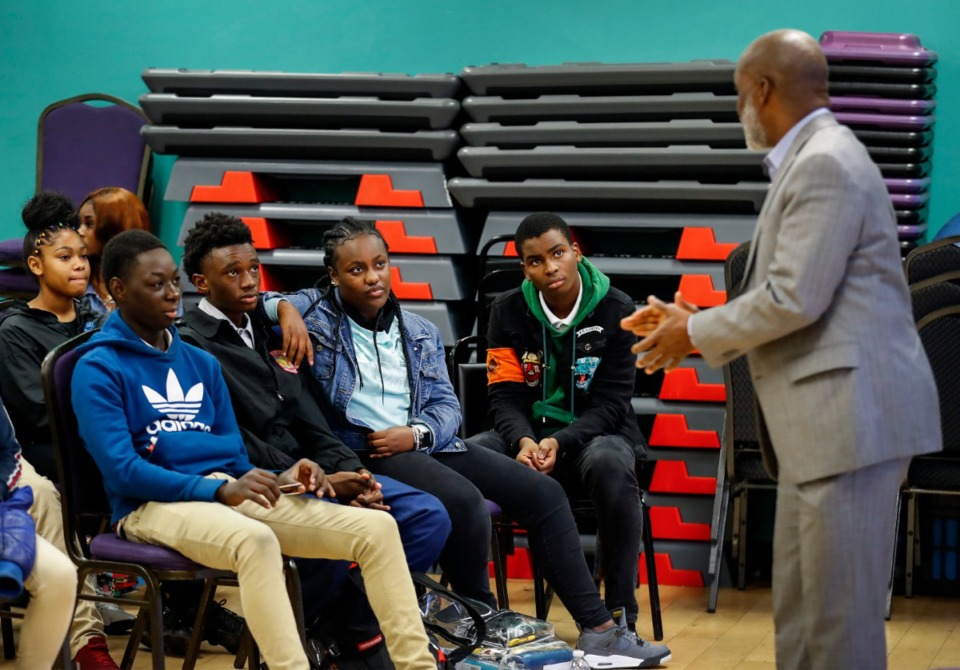 <strong>Teenagers listen to speaker Thomas DuBose (right) with State Farm during an after-school program Thursday, Nov. 21, at Davis YMCA. During Global Entrepreneurship Week, Junior Achievement of Memphis is sending 20 entrepreneurs to classrooms in Memphis to talk life skills and entrepreneurship with high school students.</strong> (Mark Weber/Daily Memphian)