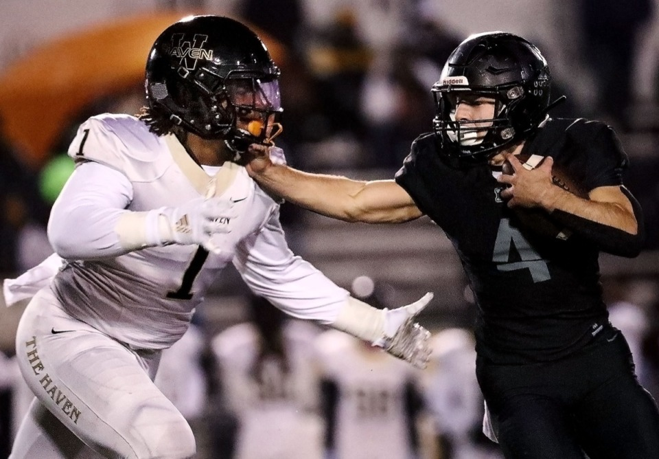 <strong>Houston running back Lincoln Pare (with ball) stiff-arms Whitehaven linebacker Bryson Eason during a Nov. 22 home playoff game.</strong> (Patrick Lantrip/Daily Memphian)