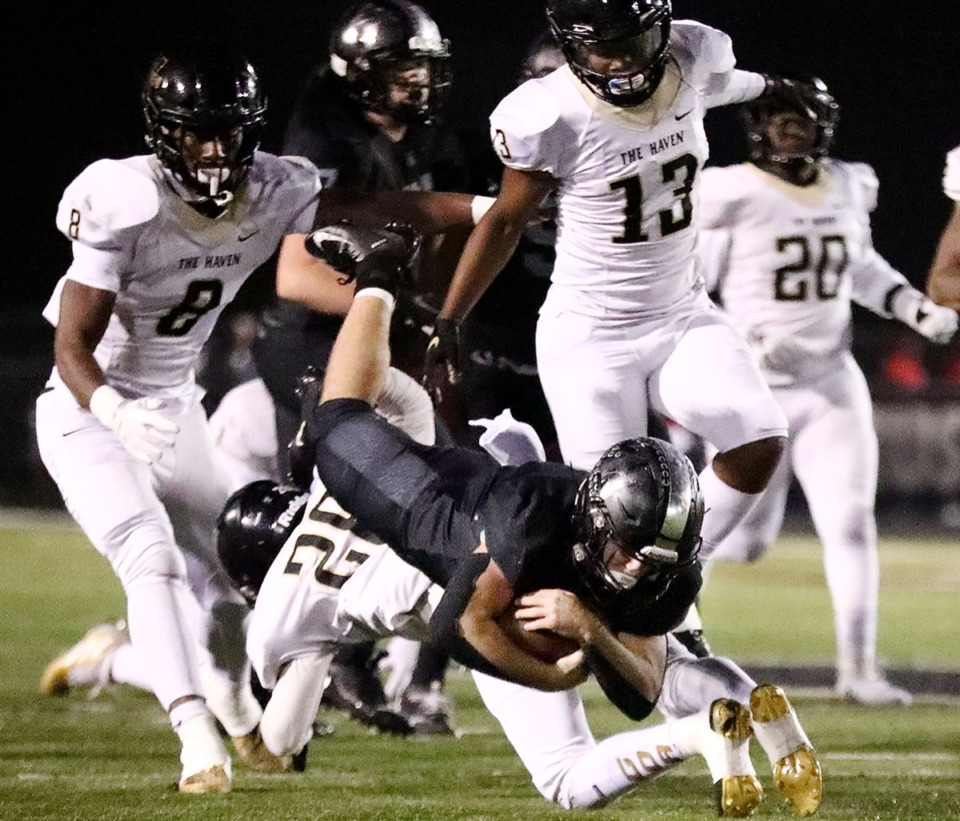 <strong>Houston running back Lincoln Pare (4) gets upended by a Whitehaven defender during a Nov. 22 home playoff game.</strong> (Patrick Lantrip/Daily Memphian)