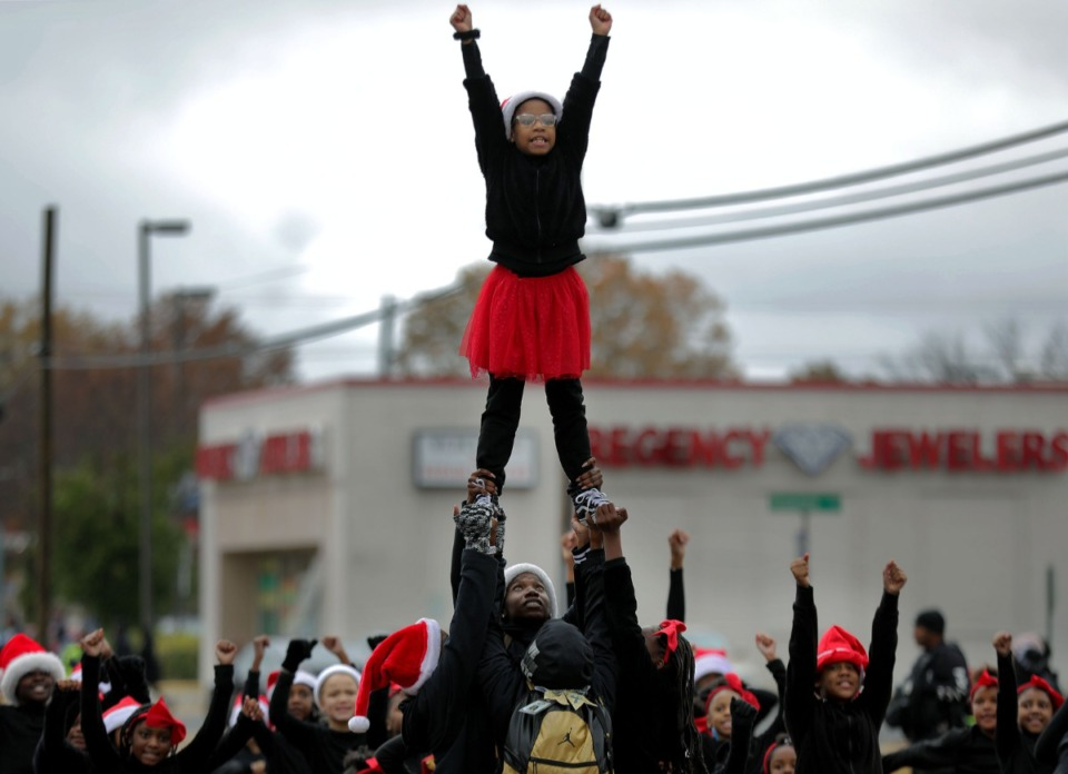 <strong>A young girl is held up during a cheer routine in Memphis Christmas Parade in Whitehaven.</strong> (Patrick Lantrip/Daily Memphian)