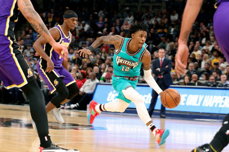 <strong>Memphis Grizzlies' Ja Morant (12) drives the ball to the basket in the first half of an NBA basketball game against the Los Angeles Lakers Saturday, Nov. 23, 2019, in Memphis, Tenn.</strong> (AP Photo/Karen Pulfer Focht)