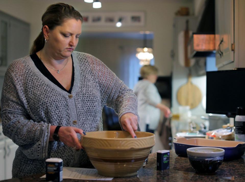 <strong>Jana Joplin Johnson (left) helps her mother Linda Joplin prepare cornbread dressing in their Cordova home Nov. 21, 2019.</strong> (Patrick Lantrip/Daily Memphian)