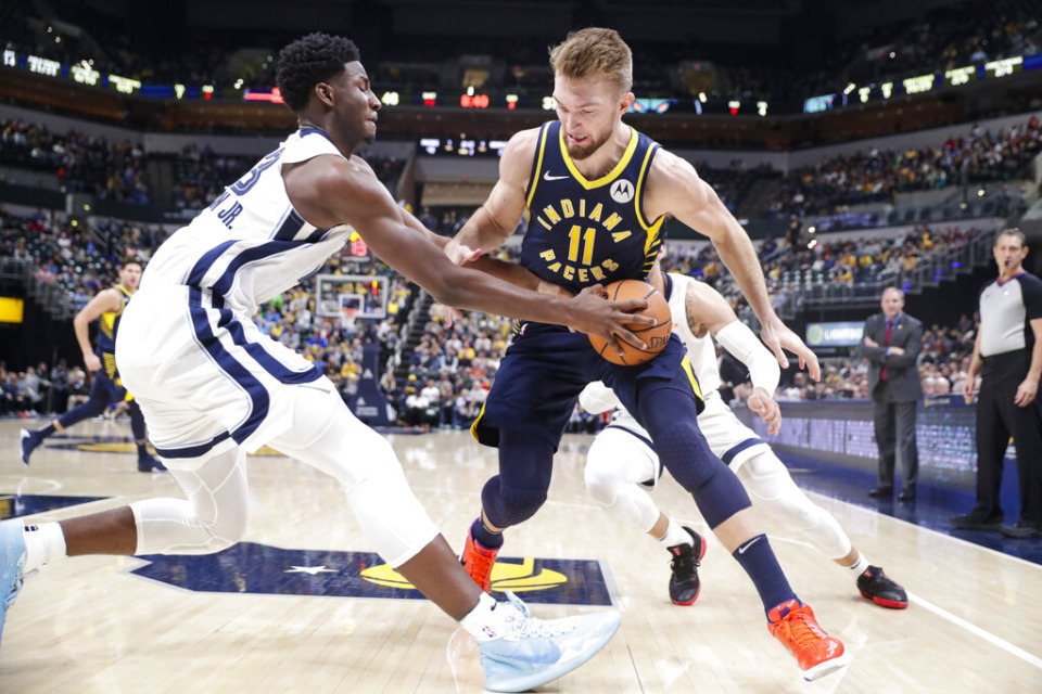 <strong>Forward Jaren Jackson Jr. (13) grabs the ball from Indiana Pacers forward Domantas Sabonis (11) Nov. 25. Jackson led the Grizz with 28.</strong> (Michael Conroy/AP)