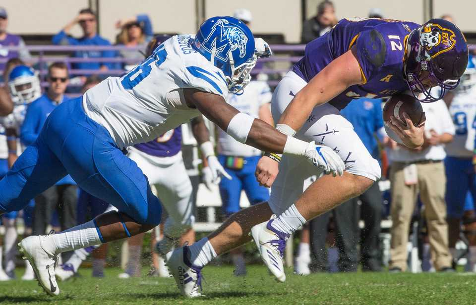<strong>East Carolina's Rowe Mellott is tackled by Nehemiah Augustus of&nbsp; the University of Memphis during ECU's game against the Tigers in Greenville, N.C., on Nov. 3, 2018.</strong> (Juliette Cooke/Courtesy of the Greenville Daily Reflector)