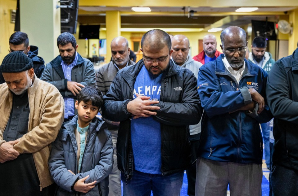 "<strong>Danish Siddiqui (center foreground, wearing Memphis shirt) prays with other Muslims at Memphis Islamic Center in Cordova during an 8 p.m. service Nov. 18. Siddiqui has organized a monthly program that encourages Memphis restaurants to add halal (""permissible"" in Arabic) options to their menus.</strong> (Mike Kerr/Special to Daily Memphian)"