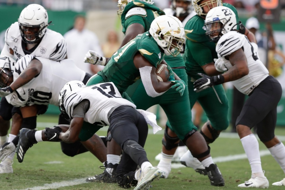 <strong>South Florida running back Dave Small scores against Memphis during the first half of the game last Saturday, Nov. 23, in Tampa, Fla. The Tigers have struggled at times this season stopping teams in first-quarter possessions.</strong> (Chris O'Meara/AP)