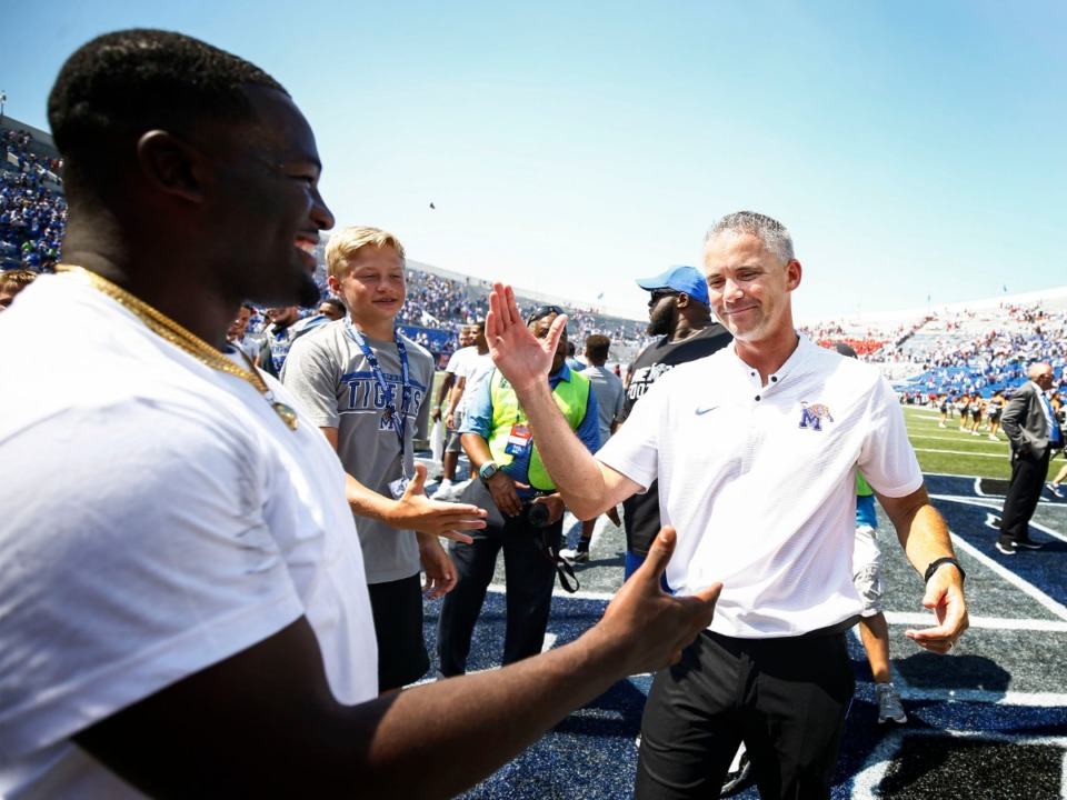 <strong>Memphis head coach Mike Norvell (right) celebrates a 15-10 victory over Ole Miss in their NCAA football game at the Liberty Bowl Memorial Stadium Saturday, August 31, 2019.</strong> (Mark Weber/Daily Memphian)