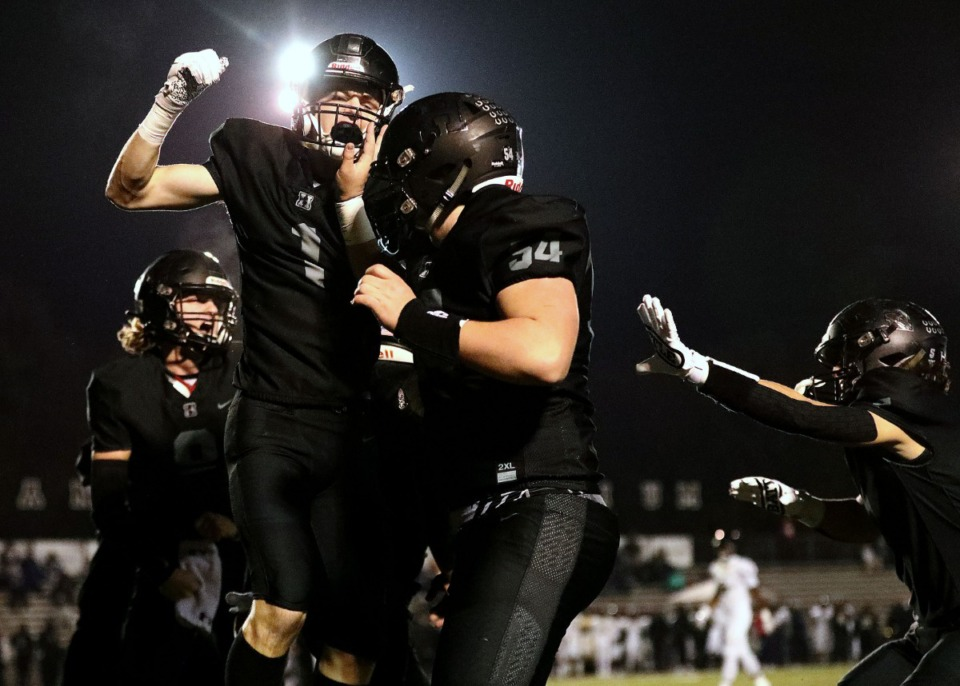 <strong>Houston High School receiver Grayson Hitt (1) celebrates with teammates after a first-quarter touchdown against Whitehaven High on Friday, Nov. 22. Houston&nbsp;defeated Whitehaven, 27-6.&nbsp;</strong> (Patrick Lantrip/Daily Memphian)