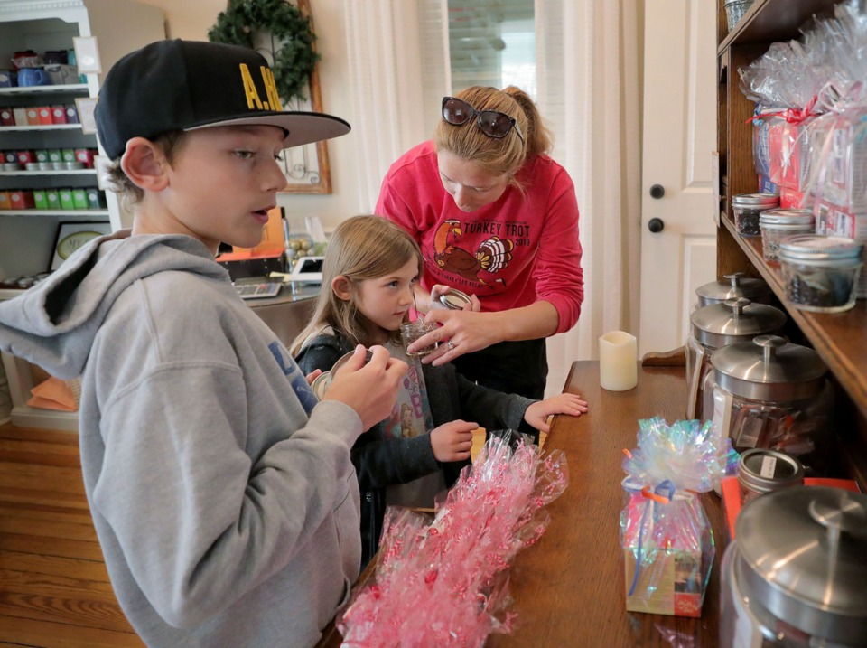 <strong>Nathan (from left), Annie and Rachael Jones smell the different varieties of tea available at My Cup of Tea in Orange Mound on Wednesday, Nov. 27.</strong> (Patrick Lantrip/Daily Memphian)