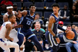 <strong>Memphis Grizzlies guard Ja Morant, right, handles the ball as Los Angeles Clippers guard Rodney McGruder, front left, and forward Maurice Harkless defend, while Grizzlies forward Jaren Jackson Jr. (13) assists Nov. 27 at FedExForum.</strong> (Brandon Dill/AP)