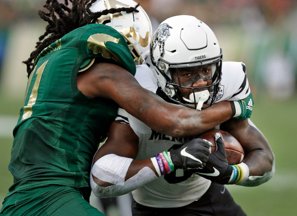 <strong>Memphis running back Patrick Taylor Jr. (6) drags South Florida linebacker Dwayne Boyles (11) into the endzone to score during the first half of an NCAA college football game Saturday, Nov. 23, 2019.</strong>&nbsp;(AP Photo/Chris O'Meara)