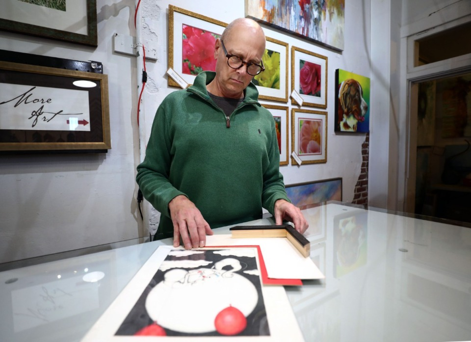 <strong>Tom Clifton, owner of T Clifton Art Gallery on Broad Avenue, prepares a custom frame Nov. 27, 2019, for a painting a customer recently purchased. In addition to custom framing, the Binghamton shop offers unique gifts, jewelry and art.</strong> (Patrick Lantrip/Daily Memphian)