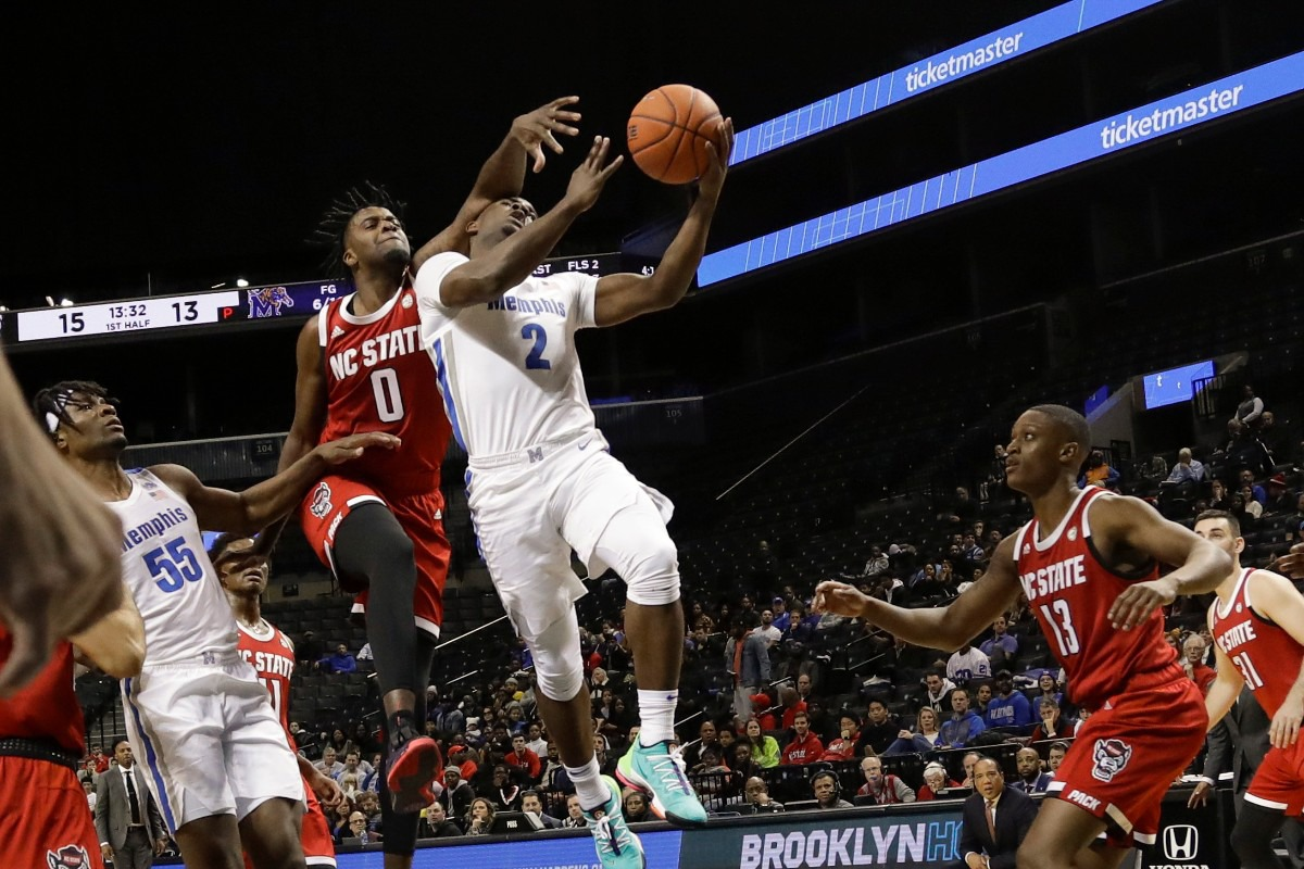 <strong>Memphis' Alex Lomax (2) drives past North Carolina State's DJ Funderburk (0) and C.J. Bryce (13) during the first half of a game in the Barclays Classic, Thursday, Nov. 28, 2019, in New York.</strong> (AP Photo/Frank Franklin II)