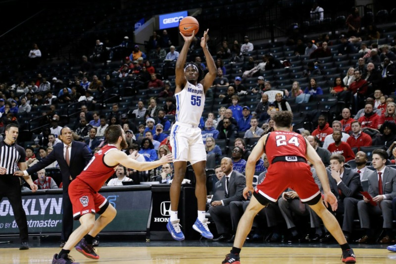 <strong>Memphis' Precious Achiuwa, center, shoots a three-point basket over North Carolina State's Braxton Beverly, left, and Devon Daniels during the first half of a game in the Barclays Classic, Thursday, Nov. 28, 2019, in New York.</strong> (AP Photo/Frank Franklin II)