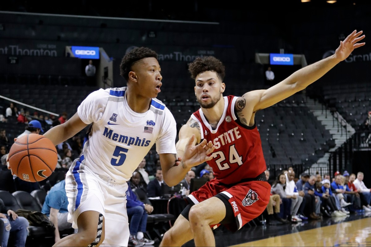 <strong>Memphis' Boogie Ellis (5) drives past North Carolina State's Devon Daniels (24) during the first half of a game in the Barclays Classic, Thursday, Nov. 28, 2019, in New York.</strong> (AP Photo/Frank Franklin II)