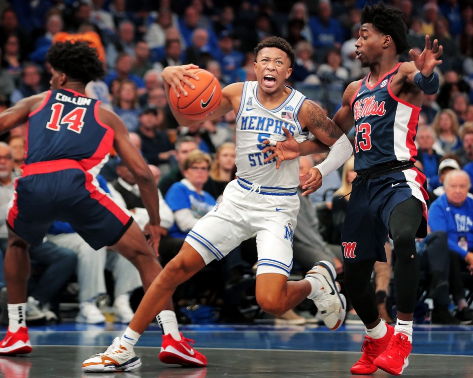<strong>University of Memphis guard Boogie Ellis (5) charges past Ole Miss guard Bryce Williams (13) during the Tigers' game on Nov. 23 at FedExForum.</strong> (Jim Weber/Daily Memphian)