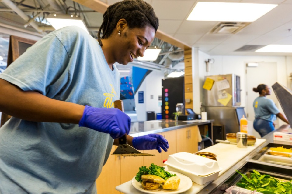 <strong>Star Edwards prepares dishes for patrons during vegan brunch hosted by Juice Almighty every third Sunday at Memphis Rox.</strong> (Ziggy Mack/Special to Daily Memphian)