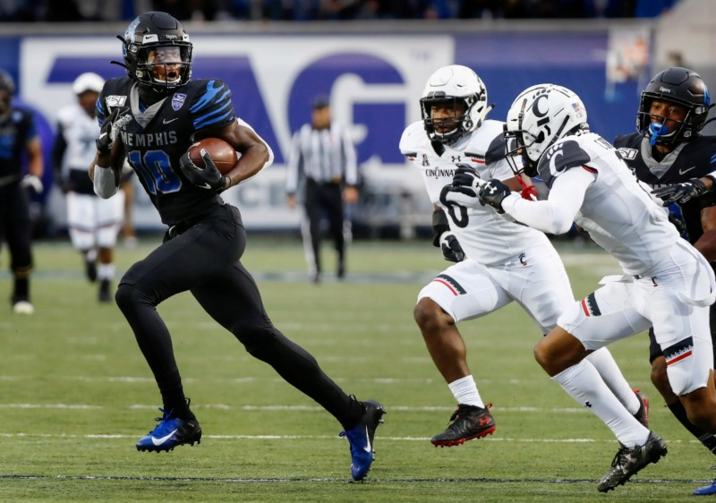<strong>Memphis receiver Damonte Coxie (left) looks back at the Cincinnati defense after making a first down catch Nov. 29 at the Liberty Bowl Memorial Stadium.</strong> (Mark Weber/Daily Memphian)