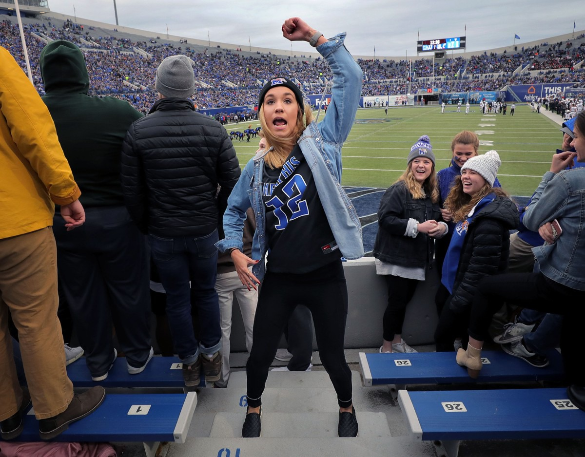 <strong>A Tigers fan goes through the University of Memphis pom squad's routine move by move during the first half of the Nov. 29 home game against the University of Cincinnati.</strong> (Patrick Lantrip/Daily Memphian)