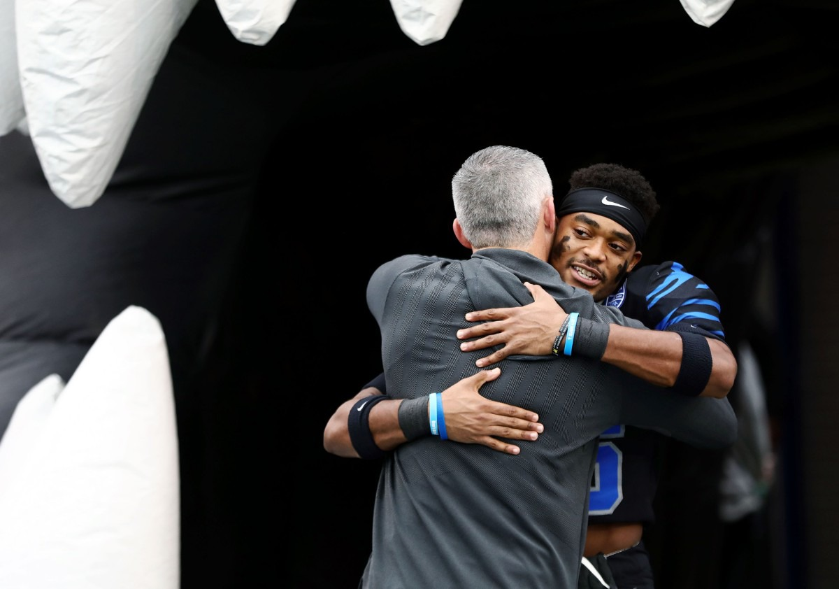 <strong>University of Memphis senior defensive back Ladarius Jordan (36) hugs head coach Mike Norvell during a ceremony honoring the U of M senior class before the Nov. 29 home game against the University of Cincinnati.</strong> (Patrick Lantrip/Daily Memphian)