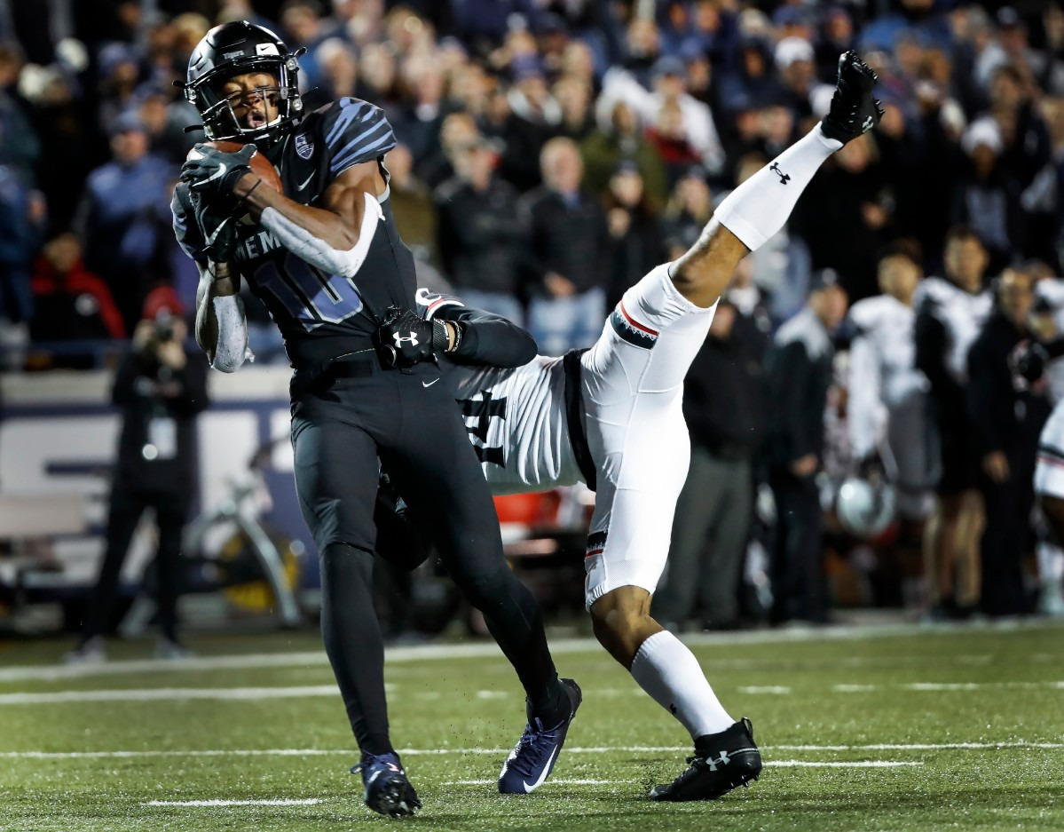 <strong>Memphis receiver Damonte Coxie (left) makes a touchdown catch against Cincinnati's Cam Jefferies (right) Nov. 29 at Liberty Bowl Memorial Stadium.</strong> (Mark Weber/Daily Memphian)