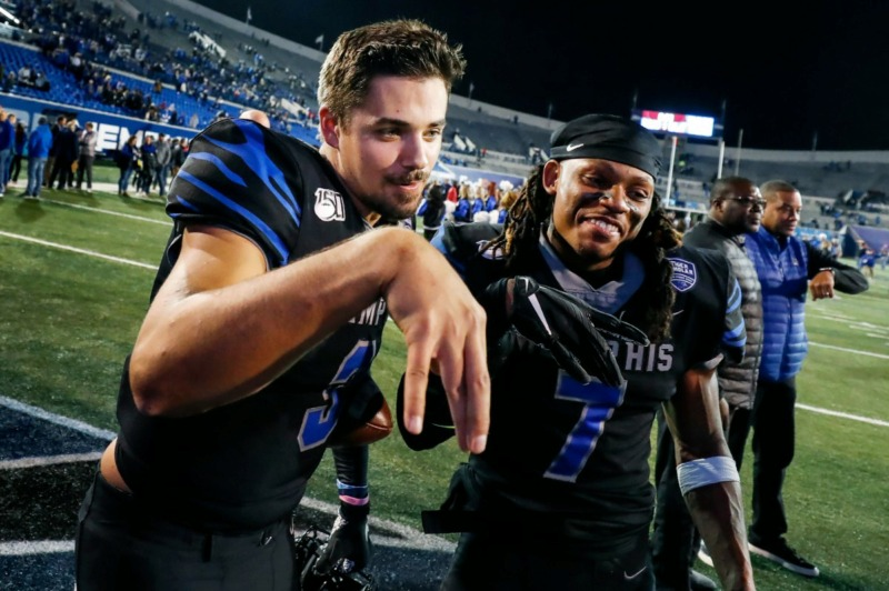 <strong>Memphis teammates Brady White (left) and Chris Claybrooks (right) celebrate after beating Cincinnati Nov. 29 at Liberty Bowl Memorial Stadium.</strong> (Mark Weber/Daily Memphian)