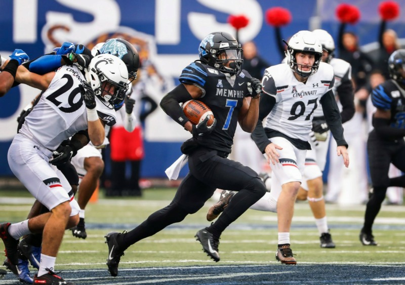 <strong>Memphis kick returner Chris Claybrooks (middle) scrambles past Cincinnati for a touchdown Nov. 29 at Liberty Bowl Memorial Stadium.</strong> (Mark Weber/Daily Memphian)