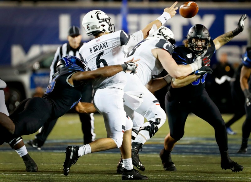 <strong>Memphis defender Bryce Huff (left) causes a fumble while sacking Cincinnati quarterback during Ben Bryant (right) Nov. 29 at Liberty Bowl Memorial Stadium.</strong> (Mark Weber/Daily Memphian)