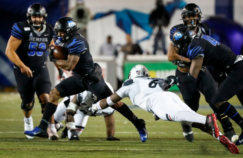<strong>Memphis running back Kenneth Gainwell (middle) runs past the Cincinnati defense for a first down Nov. 29 at Liberty Bowl Memorial Stadium.</strong> (Mark Weber/Daily Memphian)