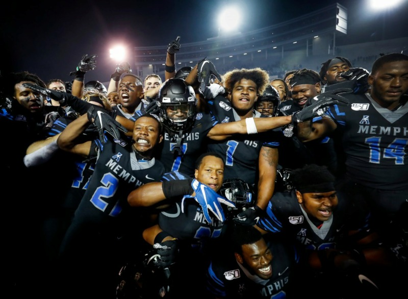 <strong>Memphis teammates celebrate after defeating Cincinnati Nov. 29 at Liberty Bowl Memorial Stadium.</strong> (Mark Weber/Daily Memphian)