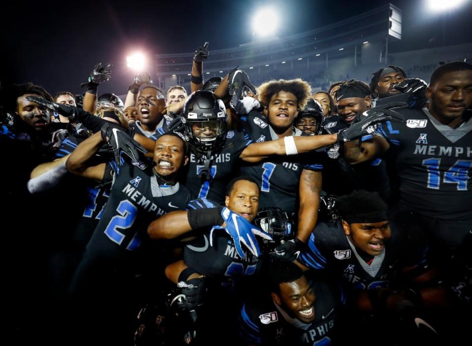 <strong>Memphis teammates celebrate after defeating Cincinnati Nov. 29 at Liberty Bowl Memorial Stadium.</strong> (Mark Weber/Daily Memphian)
