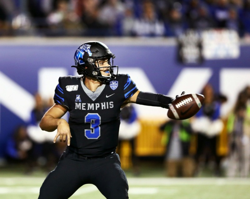 <strong>University of Memphis quarterback Brady White (3) tosses a shovel pass during a 34-24 win against the University of Cincinnati at the Liberty Bowl on Nov. 29.</strong> (Patrick Lantrip/Daily Memphian)