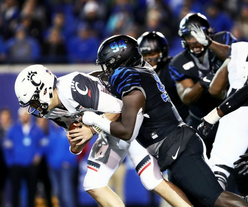 <strong>University of Memphis defensive lineman Joseph Dorceus (94) sacks University of Cincinnati quarterback Ben Bryant (6) Nov. 29.</strong> (Patrick Lantrip/Daily Memphian)