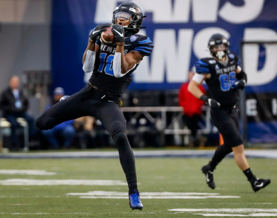 <strong>Memphis receiver Damonte Coxie makes first down catch against the Cincinnati defense during action Friday, Nov. 29, 2019 at the Liberty Bowl Memorial Stadium.</strong> (Mark Weber/Daily Memphian)