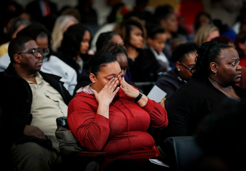 <strong>Cynthia Carruthers (middle) wipes tears away while mourning the loss of her son Antonio Fletcher during the Season of Remembrance memorial event&nbsp; Dec. 2.&nbsp;</strong> (Mark Weber/Daily Memphian)