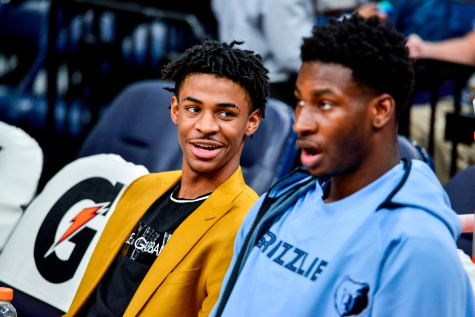 <strong>Memphis Grizzlies guard Ja Morant, left, and forward Jaren Jackson Jr. sit on the bench before an NBA basketball game against the Indiana Pacers ec. 2 at FedExForum.</strong> (Brandon Dill/AP)