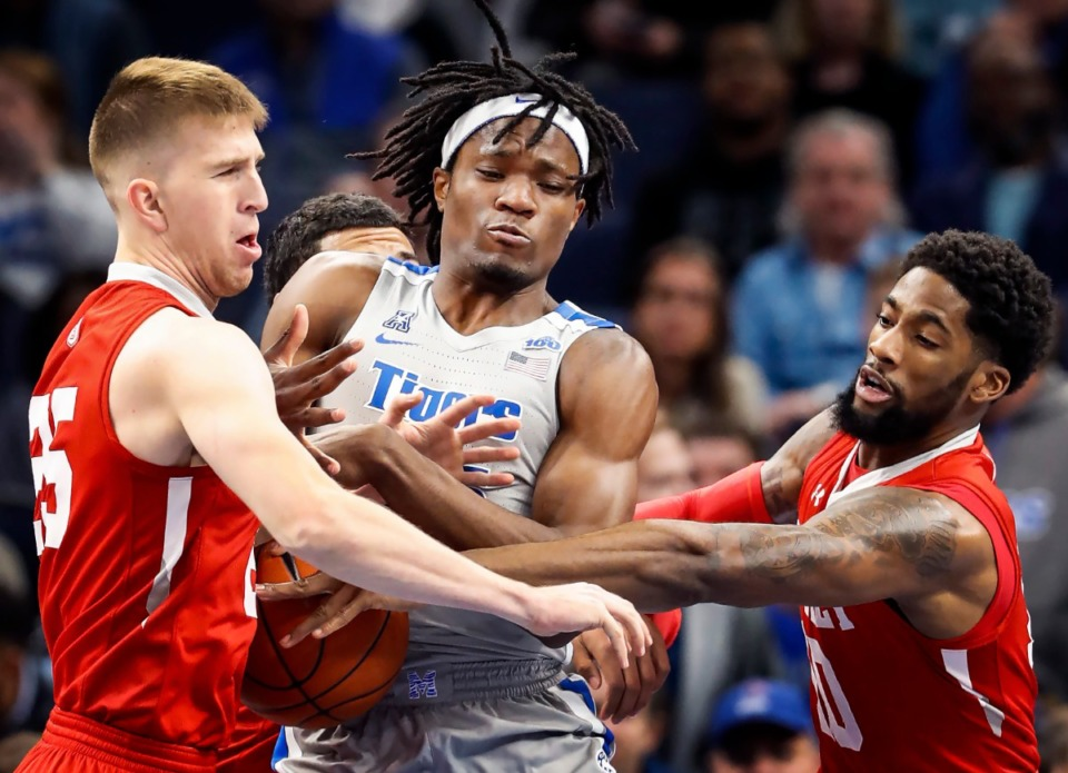 <strong>Memphis forward Precious Achiuwa (middle) battles Bradley defenders Nate Kennell (left) and Elijah Childs (right) for a rebound Dec. 3 at FedExForum.</strong> (Mark Weber/Daily Memphian)