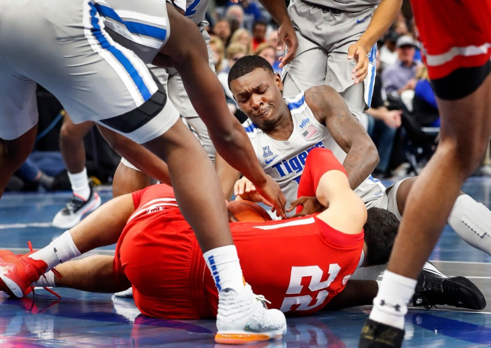 <strong>Memphis defender Lance Thomas (top) battles Bradley guard Ja'Shon Henry (bottom) for a loose ball during action Tuesday, Dec. 3, 2019 at the FedExForum.</strong> (Mark Weber/Daily Memphian)