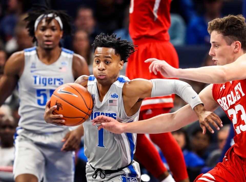 <strong>Memphis guard Tyler Harris (left) grabs a loose ball away from Bradley guard Ville Tahvanainen (right) during action Tuesday, Dec. 3, 2019 at the FedExForum.</strong> (Mark Weber/Daily Memphian)