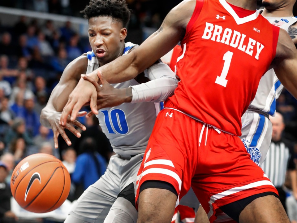 <strong>Memphis Damion Baugh (left) battles for a loose ball during actin against the Bradley defense during action Tuesday, Dec. 3, 2019 at the FedExForum.</strong> (Mark Weber/Daily Memphian)