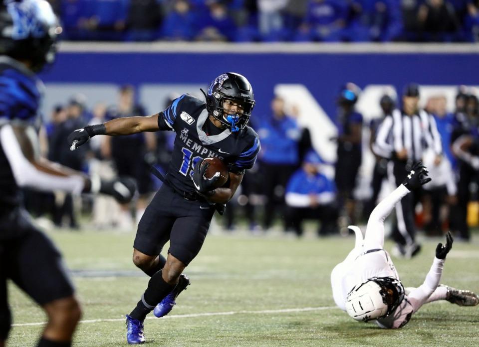 <strong>University of Memphis running back Kenneth Gainwell (19) breaks a tackle during a long fourth quarter run against the University of Cincinnati on Nov. 29, 2019.</strong> (Patrick Lantrip/Daily Memphian)