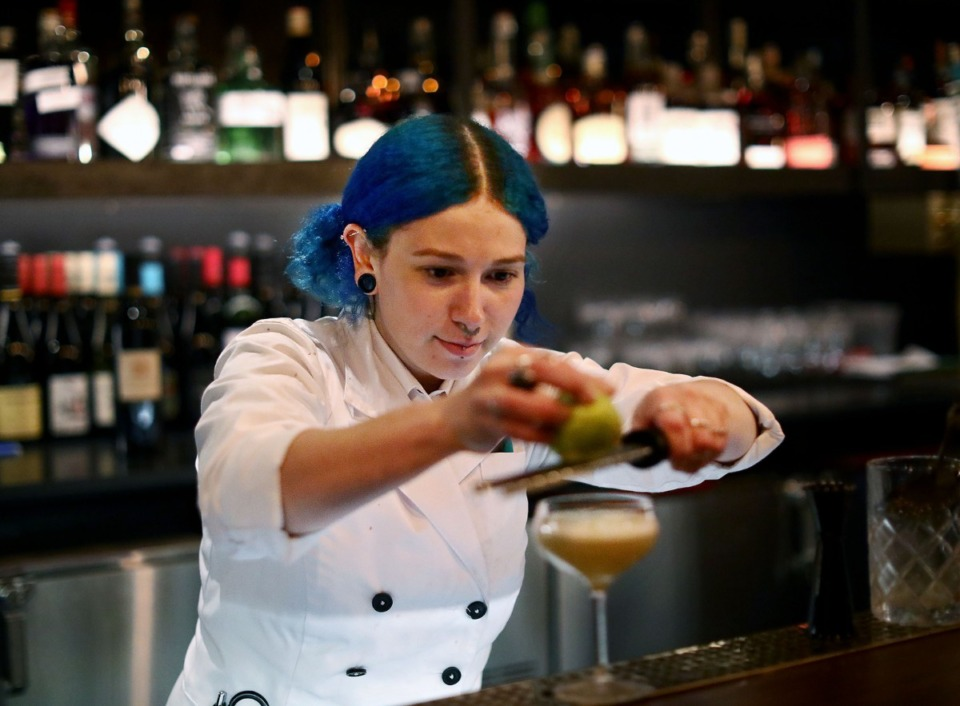 <strong>Bartender Rachel Barba puts the finishing touches on a handcrafted cocktail at the Tuesday, Dec. 3, soft opening of Bishop in the Central Station Hotel.</strong> (Patrick Lantrip/Daily Memphian)