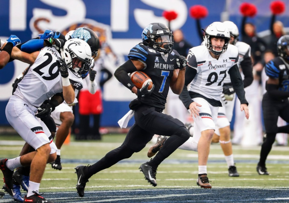 <strong>Memphis kick returner Chris Claybrooks (middle) scrambles past the Cincinnati defense for a touchdown during action Friday, Nov. 29, 2019.</strong>&nbsp;(Mark Weber/Daily Memphian)