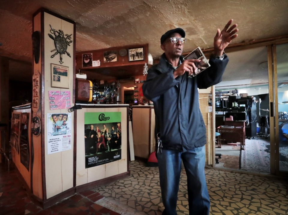 <strong>Darryl Wells Sr., 65, talks about the layout of the basement business that taught sewing and fashion design in Gladys &ldquo;MaDear&rdquo; Bennett's house, where Wells lived as a child. The house on Delmar is being submitted to the National Trust for Historic Places because of its significance during the striving of black entrepreneurs in an era of segregation and Jim Crow Laws.</strong> (Jim Weber/Daily Memphian)