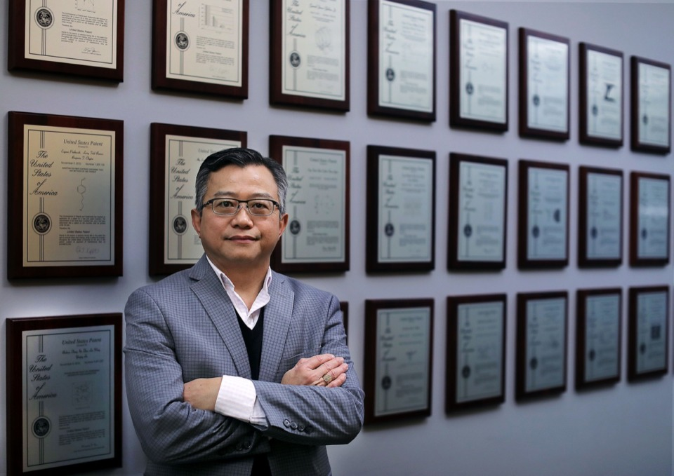 <strong>Hai Trieu, who has 130 patents of his own, stands in front of a wall of patents belonging to the University of Memphis at the FedEx Institute of Technology Dec. 6. Trieu has been selected as a 2019 Fellow for the National Academy of Inventors.</strong> (Patrick Lantrip/Daily Memphian)